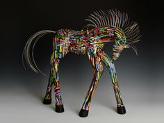 The polymer-clay horse art by Judy Summer will be showcased during Artique's First Friday opening reception on April 3. (Courtesy of Judy Summer)