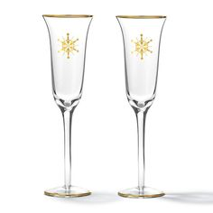 "Bring the celebration to the next level with a hint of glint. Special occasions like the holidays call for elegant accents. FEATURES• 9.5"" high 2.5"" diameter• Set of 2 glasses with gold snowflake printingMATERIALS• GlassCAREHand wash only.Made in China"