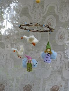 needle felted mobile, fairies flying after geese. Made4uByMagic via Etsy.