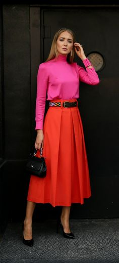 Bold Colors + Classic Style // Fuchsia pink bow-tie blouse, orange pleated midi skirt, small black sicily bag, classic black pumps + beaded leather belt {Dolce & Gabbana, Milly, Tibi, Saint Laurent, colorblocking, statement dressing, classy dressing, bold colors}