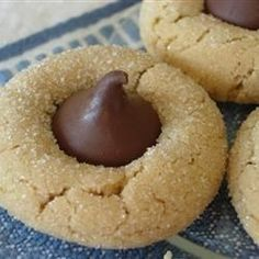 Peanut butter cookies are baked for 10 minutes, topped with a chocolate candy kiss, then baked until golden. Great for cookie trays!