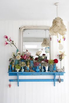 a lovely shelf in a lovely color, filled with lovely vases...