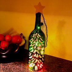 Cute idea! Christmas lights in a wine bottle.