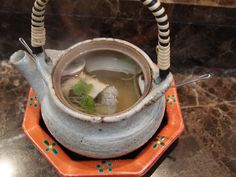 Steam-boiled pike eel in an earthenware teapot (hamo dobin mushi)