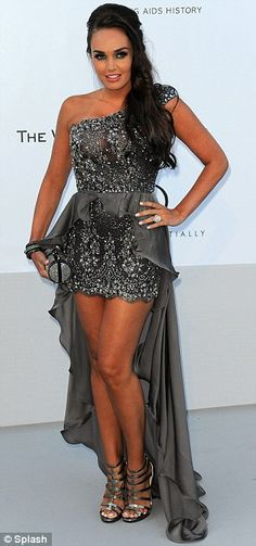 Tamara Ecclestone needs some posture lessons! I like the dress but she's not standing right to do it justice