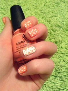 Beautiful poka-dot nails. orange and white
