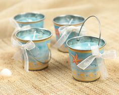 candle in a bucket.  Great  as a beach wedding favor