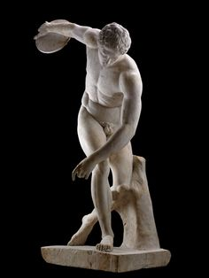The Discobolus: marble statue of an athlete stooping to throw the discus. One of several Roman copies made of a lost bronze original made in the century BC by the sculptor Myron. The head is wrongly restored and should be turned to watch the discus. Ancient Greek Sculpture, Ancient Greek Art, Greek Statues, Ancient Greece, Roman Sculpture, Art Sculpture, Sculptures, Chef D Oeuvre, Oeuvre D'art