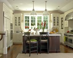 white cabinets and brown island by esther