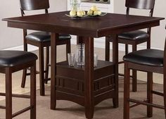 Lazy Susan Dining Room Set Beauty, function and form is provided with this counter height dining table with seating for up to four. Covered in a dark rosy brown finish, it features a square or round shaped table top with a functional built-in Lazy Susan and a lower square shaped storage unit.  Match this dining table with counter height chairs in a lovely wood finish, clean lined back supports and cushion upholstered seats.