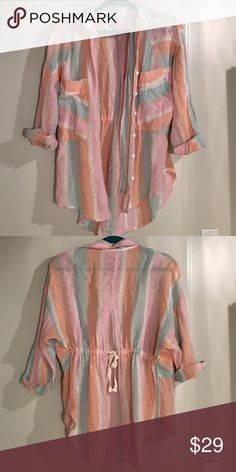 Free People beautiful pastel linen and cotton top Free People pastel striped 55% linen 45% cotton top. So comfortable. Drawstring in the back. Size Small but fits a little larger. Worn 2-3 times. Free People Tops Button Down Shirts