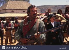 RELEASE DATE: October 17, 1990 TITLE: Quigley Down Under STUDIO: MGM DIRECTOR: Simon Wincer PLOT: Sharpshooter Matt Quigley is hired from Montana by an Australian rancher paying a very high price. But when Quigley arrives Down Under, all is not as it seems. PICTURED: TOM SELLECK stars as Matthew Quigley.
