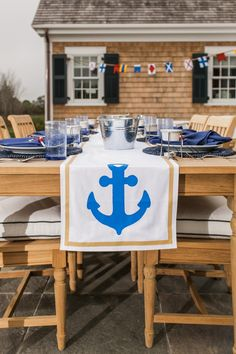 A nautical style table runner and place settings by blogger Ann Le are prepared for a clambake at the HGTV Dream Home 2015 in Martha's Vineyard. Take the Tour on Completely Coastal: http://www.completely-coastal.com/2015/01/hgtv-dream-home-2015-marthas-vineard.html