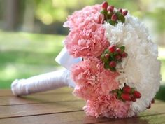 Biedermeier style bridal bouquet  Beautiful wedding flowers display of pink and white carnation bridal bouquet
