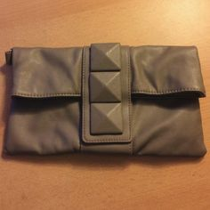 Gray clutch Never used grey clutch that folds over and clicks shut. Three larger studs on front. No imperfections or rips. Macy's Bags Clutches & Wristlets