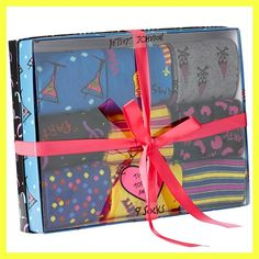 NWT Betsey Johnson 9 Pair PartySock Gift Box   Authentic NWT Betsey Johnson 9-Pair Party Themed Trouser Sock Gift Box Set  One Size Fits Most!  Super fun and colorful celebration themed sock gift box set! Comes packed in a sturdy, reusable celebration-themed Betsey Johnson gift box  Socks are 80% Acrylic / 20% Nylon  Brand new in box, perfect condition, never opened!  Designs include vibrant stripes, martini glasses, party hats, confetti, party animal print and more!   No Trades!  Betsey…