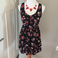 Adorable Sleeveless Fit & Flare Long zip up back- thick material with flowered pattern. So cute on and flattering !! Only worn once. Forever 21 Dresses Midi