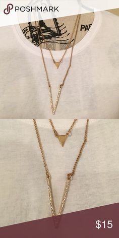 SALE Gold Jewel boutique v shape necklace Worn a few times and has some tarnish on the back near the clasp. The clasp is adjustable Jewelry Necklaces