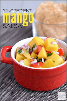 This Quick Easy 5 Ingredient Mango Salsa Recipe is TOO. DIE. FOR. Loaded with super fruits, under 150 calories per cup and full on taste.