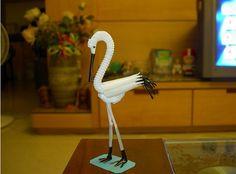 Balance: This straw flamingo is balancing on two thin straw legs
