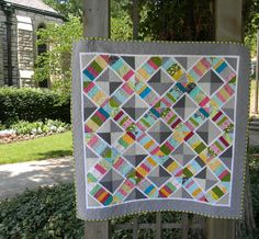 I pieced and chopped my multicolored strip sets  into string-x blocks . The quilt reminds me of a flowery lattice against a stone wall. T...