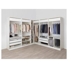 Explore this dream walk-in closet. IKEA PAX wardrobe and KOMPLEMENT open storage shelves, boxes, drawers, and interior organizers make it light and airy. Ikea Pax Corner Wardrobe, Ikea Closet, Diy Wardrobe, Corner Closet, Wardrobe Storage, Ikea Walk In Wardrobe, Wardrobe Sets, Attic Closet, Bedroom Closet Design