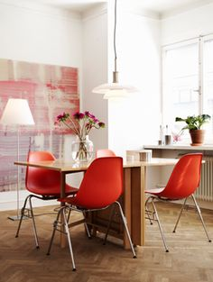 red eames chairs..