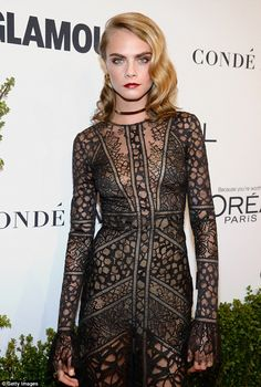 Model figure:Wearing a gold choker, the slim model slipped her figure into a lacy sheer black gown that left very little to the imagination