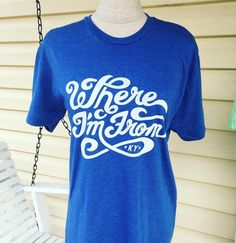 Show 'em where you're from wherever you go with our new Where I'm From design! The swirling, whimsical typography is hand-silkscreened on a super soft royal blue tri-blend t-shirt to give the shirt a vintage feel.