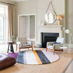 layered rugs in an australian mansion...via roseland greene