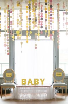 Yellow and grey were the colors soon-to-be parents Lucy + Kevin chose for their wedding, so when it came to planning their baby shower, with the help of Wu La La Event Design, they chose that same pal
