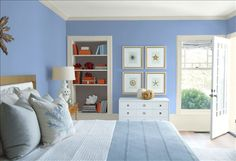 Look at the paint color combination I created with Benjamin Moore. Via @benjamin_moore. Wall: Steel Blue 823; Trim: Wind's Breath OC-24; Bookcase Back Wall: Silhouette AF-655; Ceiling: White Heron OC-57.