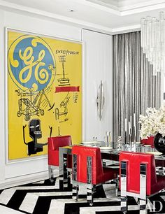 DINING ROOM Another Andy Warhol–Jean-Michel Basquiat collaboration presides over the dining room, where vintage Paul Evans chairs from Craig Van Den Brulle are grouped with an Evans-inspired table; the custom-made rug is by Kyle Bunting.