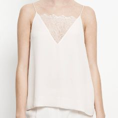 Biaf Lace Cami In White Sand: This strappy vest top by Samsoe & Samsoe features a fine lace insert at the front and a curved back neckline. Delicate straps frame this chic woven vest top which is finished inside with a fine chiffon lining. The flowy fit is perfect for the spring/summer seasons, the 'Biaf' cami is a great transitional piece as it looks just as good used as a layering base as it does by itself paired with your favourite denim. -V-neck with lace insert -Thin spaghetti straps…