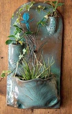 Sew It DIY: wall pockets. I might try olPots, Clay, such hand-built wall fountain/planter Hand Built Pottery, Slab Pottery, Ceramic Pottery, Pottery Art, Ceramic Wall Art, Ceramic Clay, Ceramic Wall Planters, Planter Pots, Pottery Designs