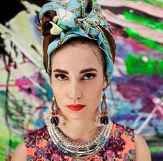 Of the many ways to wear a vintage printed scarf, we might just love the contrast-pattern headwrap style the most. #etsyfashion