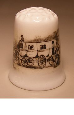 carriage rides porcelain thimble These are for sale by https://www.speelgoedenverzamelshop.nl/vingerhoedjes/vervoersmiddelen/koets_bedrukt_op_een_porselein_vingerhoedje_(hmkoets01).html