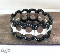 armband van blikopeners Recycled Pop Tab and Crochet Bracelet in Black by StellaStory Soda Tab Crafts, Can Tab Crafts, Bottle Cap Crafts, Tape Crafts, Soda Tab Bracelet, Pop Top Crafts, Bracelet Crochet, Jewelry Crafts, Handmade Jewelry