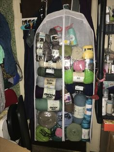 CHEAP YARN STORAGE FOR SMALL SPACES :) I bought a garment bag from Walmart for $3 and carefully stacked my yarn inside it so that I can hang it behind my door or in my closet. It holds a lot of yarn and can get heavy so use a couple hangers inside the bag. I might use a second bag and shorten both of them to distribute the weight better