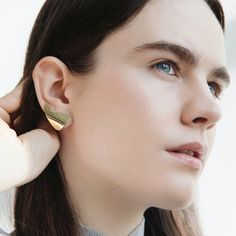 """Cairn Crawlers by Faeber Studio  Perfect for those strong women in your life, these ear-climbers can represent their monumental strength in a material way. They can be slid lengthwise up the lobe to """"crawl"""" the ear or can be turned vertically to make them dangle down a little."""