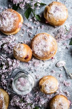 Strawberry Jelly and Vanilla Cream Brioche Doughnuts with Lilac Sugar. /