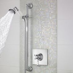 Get the wow factor but save on costs by just doing a simple vertical stripe in your shower