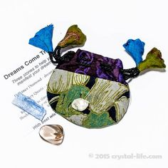 Dreams Come True Gemstone Collection - three stones to help you manifest your dreams: Herkimer Diamond, Smokey Quartz, Kyanite. Comes in small drawstring silk bag (of varying colors), with descriptive brochure.