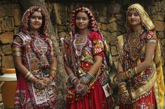 India gears up for 'Navratri' - Women dressed in traditional finery watch others practice the Garba dance ahead of the Navratri festival in Ahmedabad. 'Garba' is an important part of celebrations in Gujarat during the nine nights festival that begins on October 5, 2013. (AP)