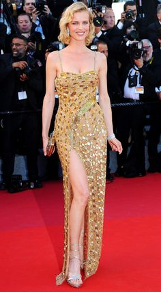 EVA HERZIGOVÁ : She's still got. The 44-year-old supermodel shows off her posing skills in a gold, high-slit gown.