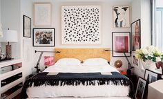 An eclectic bedroom with an abundance of wall art.