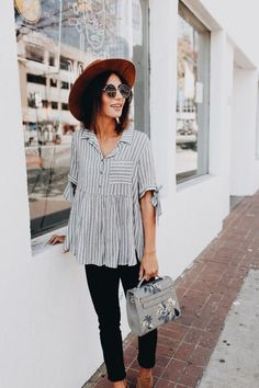 Cute striped top with black jeans and burgundy hat.