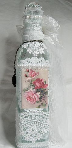 Quite Beautiful and this is the back of the bottle! Inspiration: I'm strictly guessing here but I've seen bottles done with doilies so I'll say doilies in the back, gorgeous roses print, fabric doilies in the front, lots of lace, some pearls... Shabby Chic Altered Bottle for Martica's Swap - Back