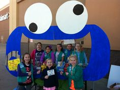 Who wouldn't stop to see Cookie Monster?! Great idea for a Girl Scout cookie booth.
