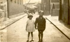 Young girl and boy standing hand in hand in Catherine Wheel Yard Brentford. (1932)